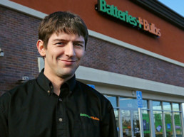 man in front of batteries plus store