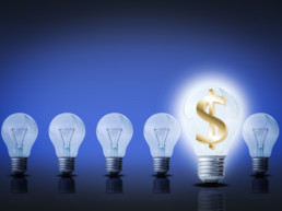 graphic of light bulbs, one with a dollar sign inside