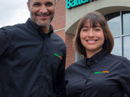 Tow Owners smiling knowing that Batteries Plus Bulbs is rank 131 by Franchise Times