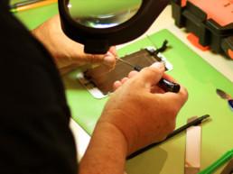 CTIA certified tech working on a phone