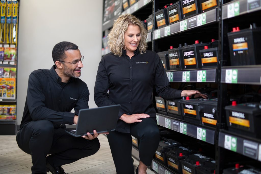 Batteries Plus employees checking inventory