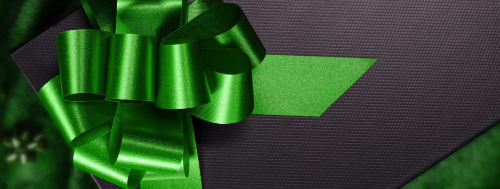 Green bow on black background