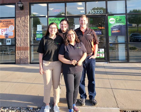 Kopp Family standing outside their Batteries Plus Store