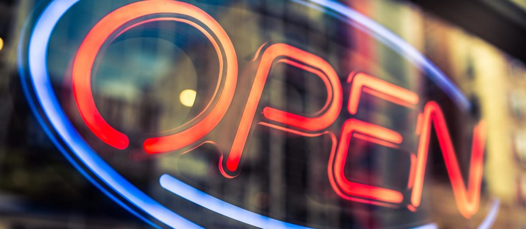 Open sign in a window lit up