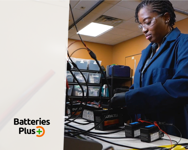 Batteries Plus employee checking the batteries.